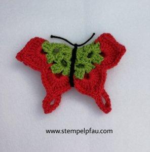 Schmetterling gehäkelt aus 100% Baumwolle in grün und rit